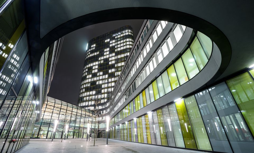 Exterior of modern illuminated building, Munich, Bavaria, Germany