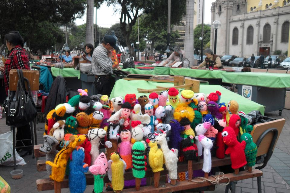 Knitted finger puppets in Parque Kennedy, Lima.