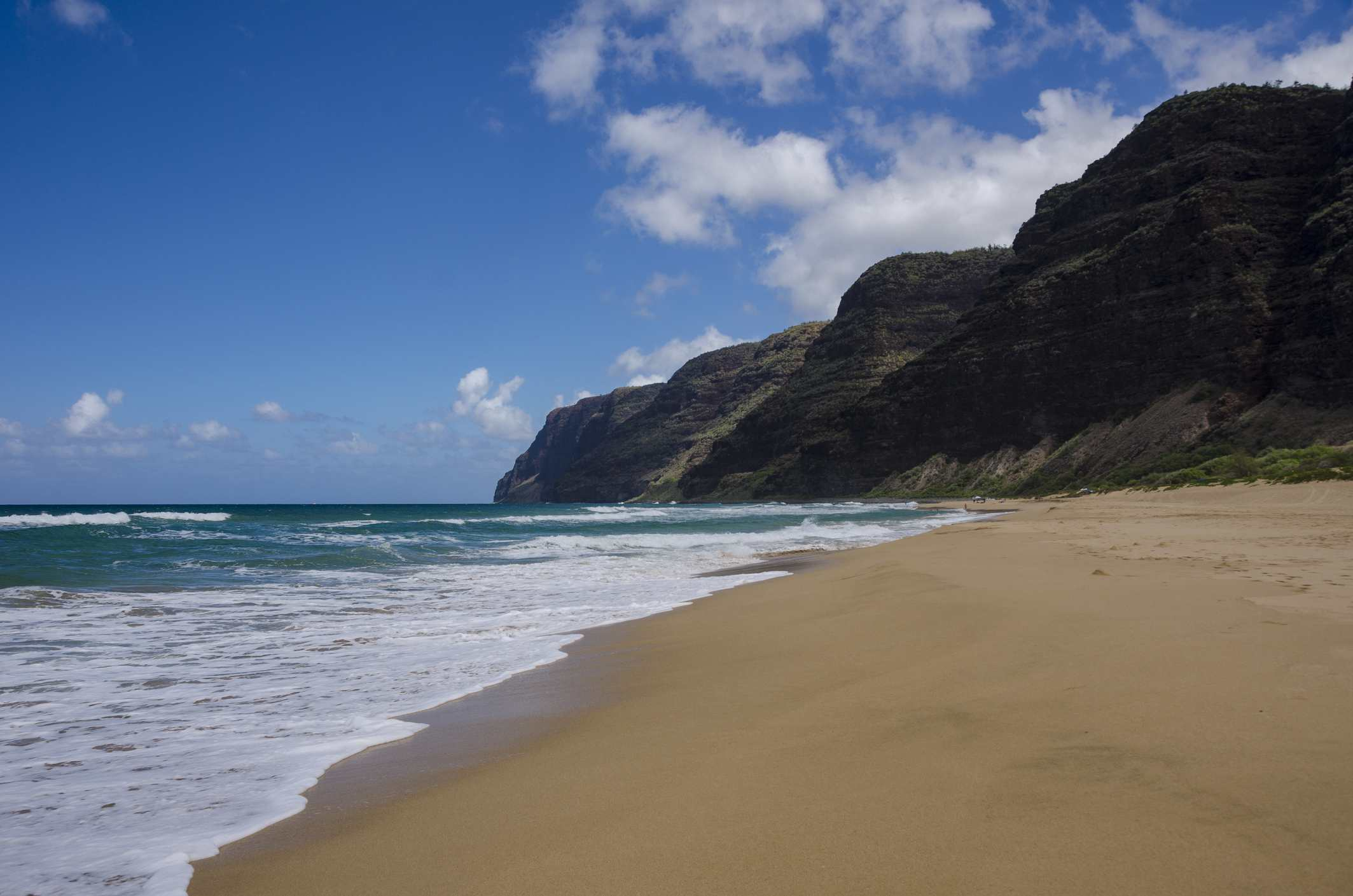 A view of the south end of the Napali Coast on the island of Kauai as seen from Polihale Beach.