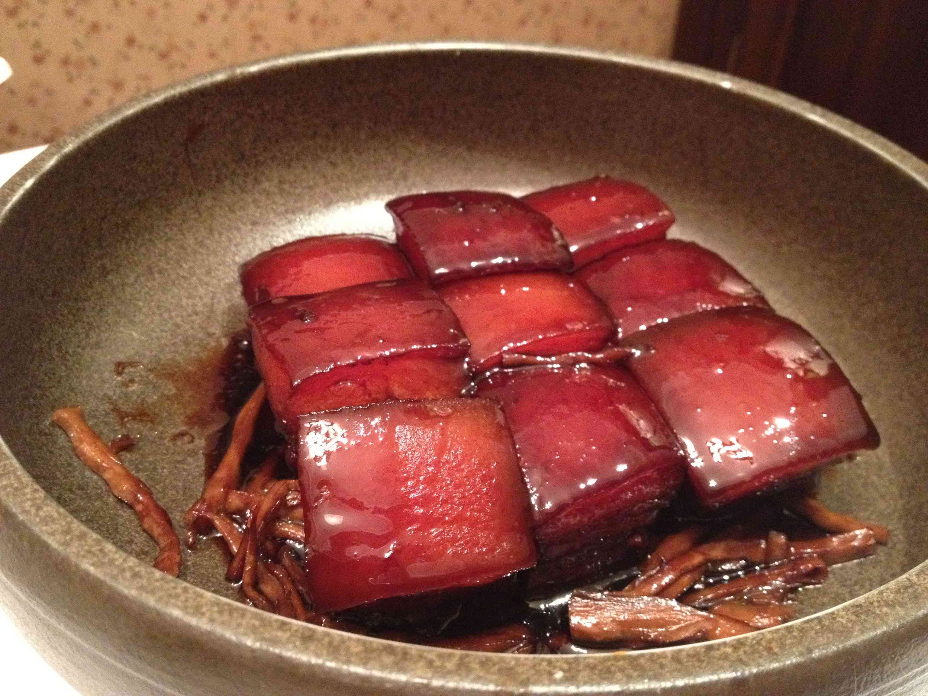Nine pieces of red braised pork belly in a bowl