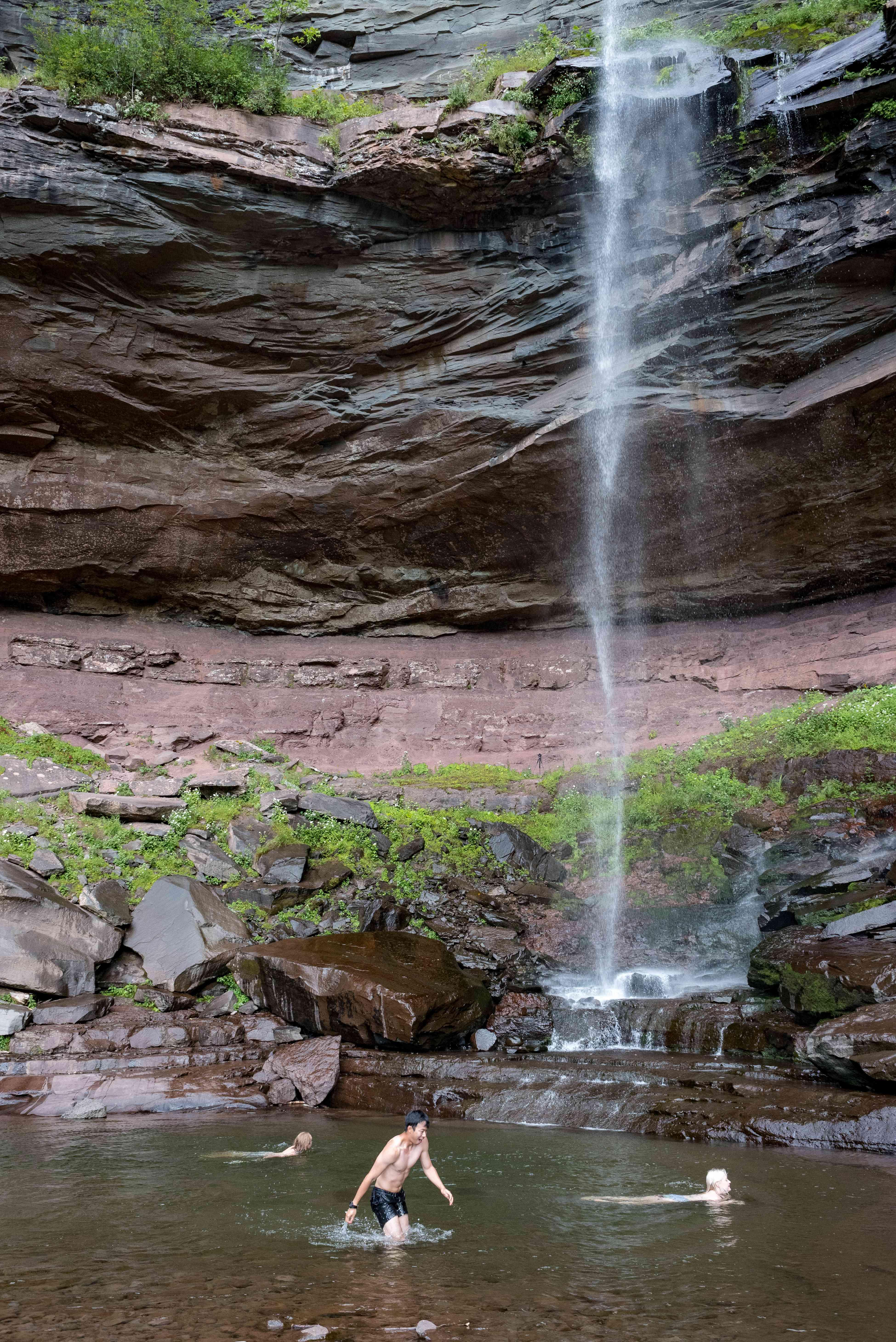A man swimming under Kaaterskill Falls
