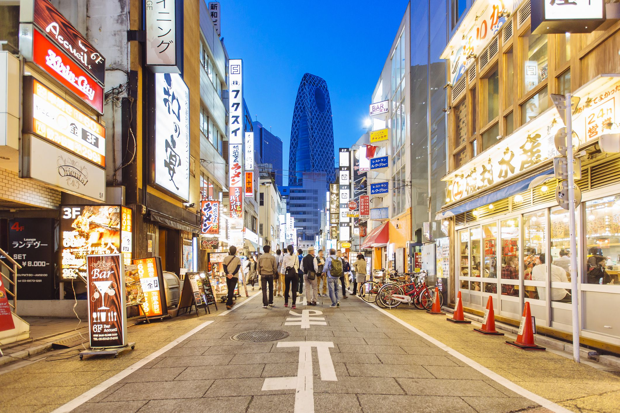 Street with shops and restaurants in Shinjuku district in Tokyo, Japan