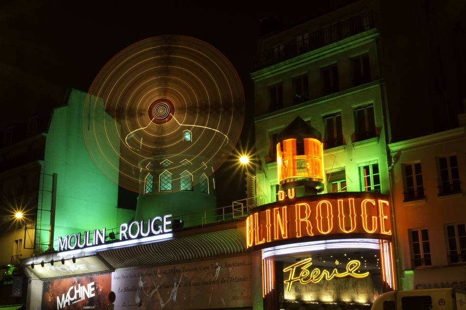 Moulin Rouge, the most famous cabaret in Paris wraps in green for Saint Patrick's day.