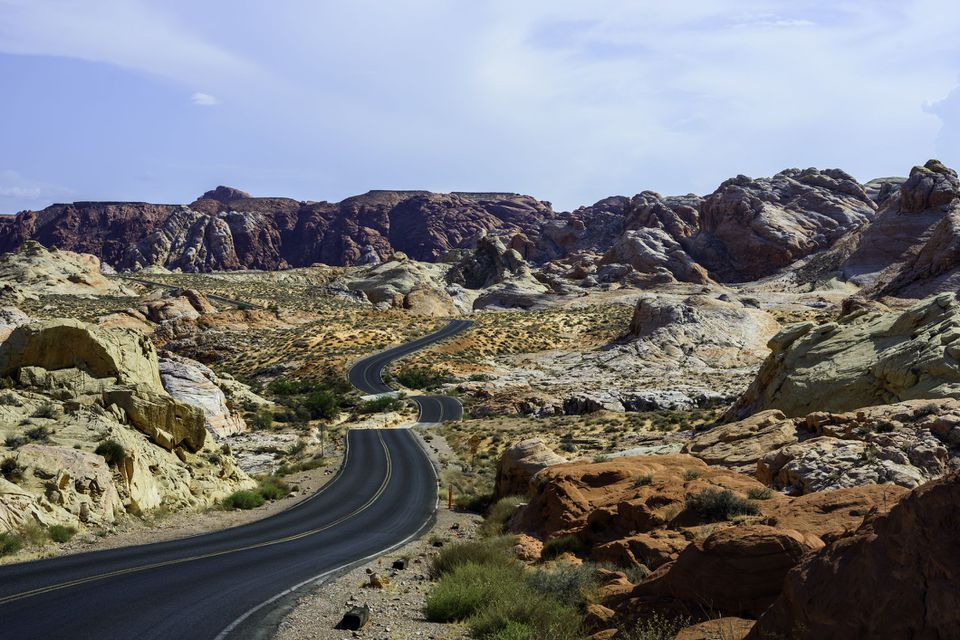Desert Road with Red Rock in Desert