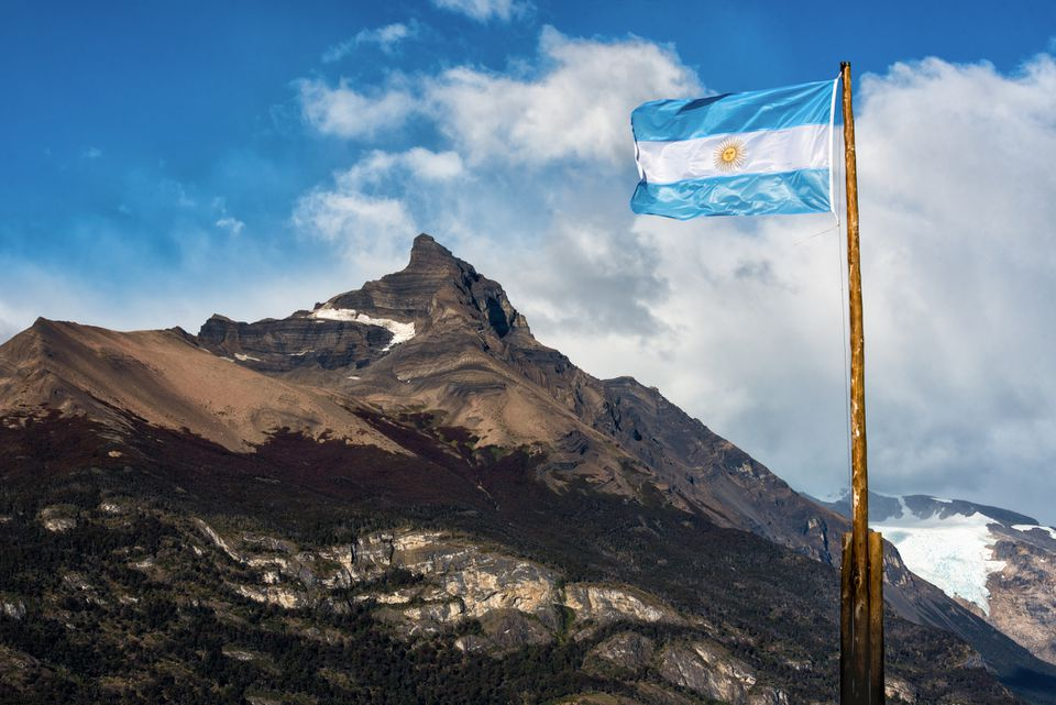 Argentine flag flying in front of the mountain Cerro Moreno