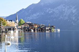 View of buildings and swans on Lake Hallstatt