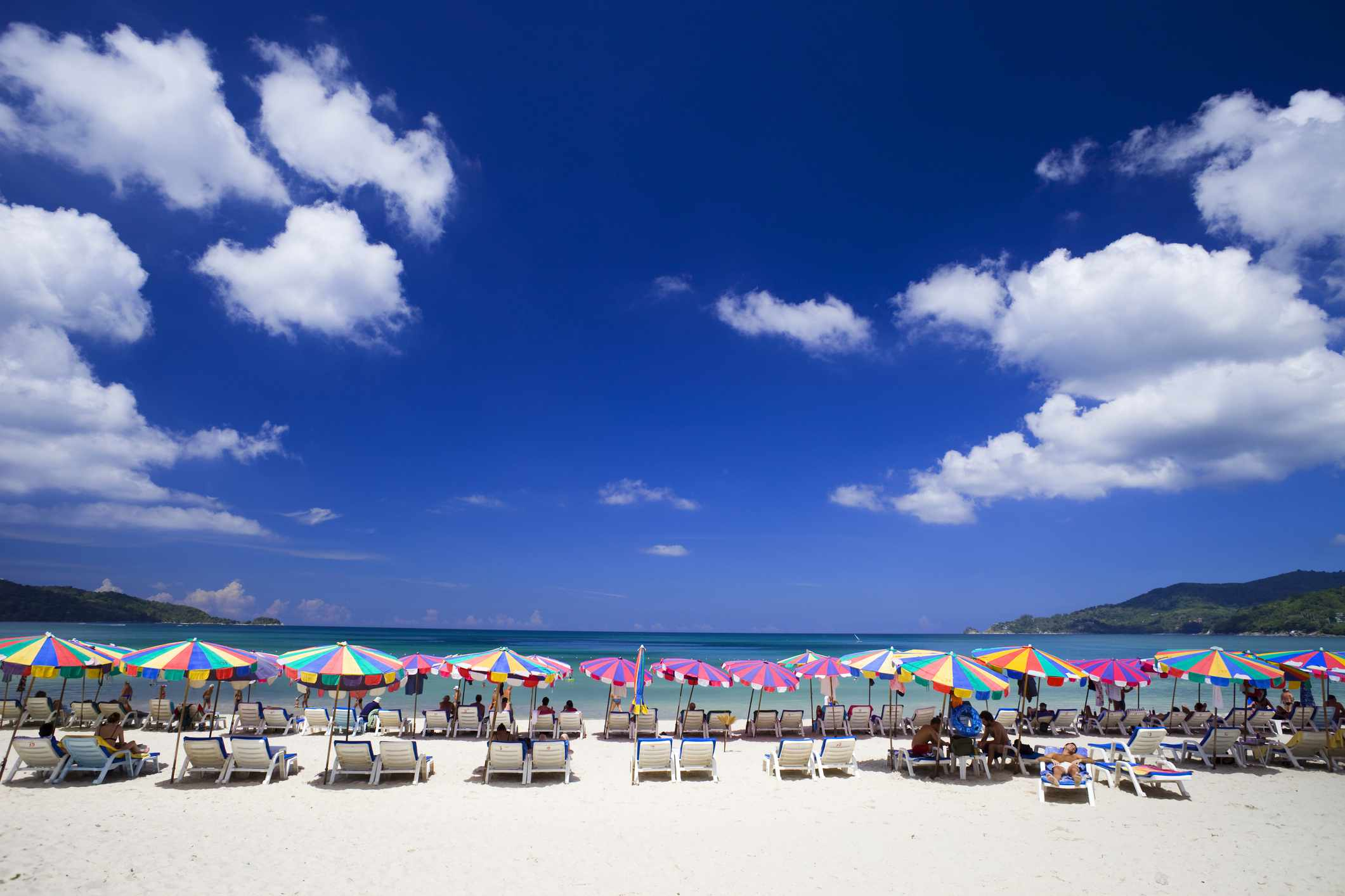 Colorful Umbrellas Line Patong Beach In Phuket Thailand