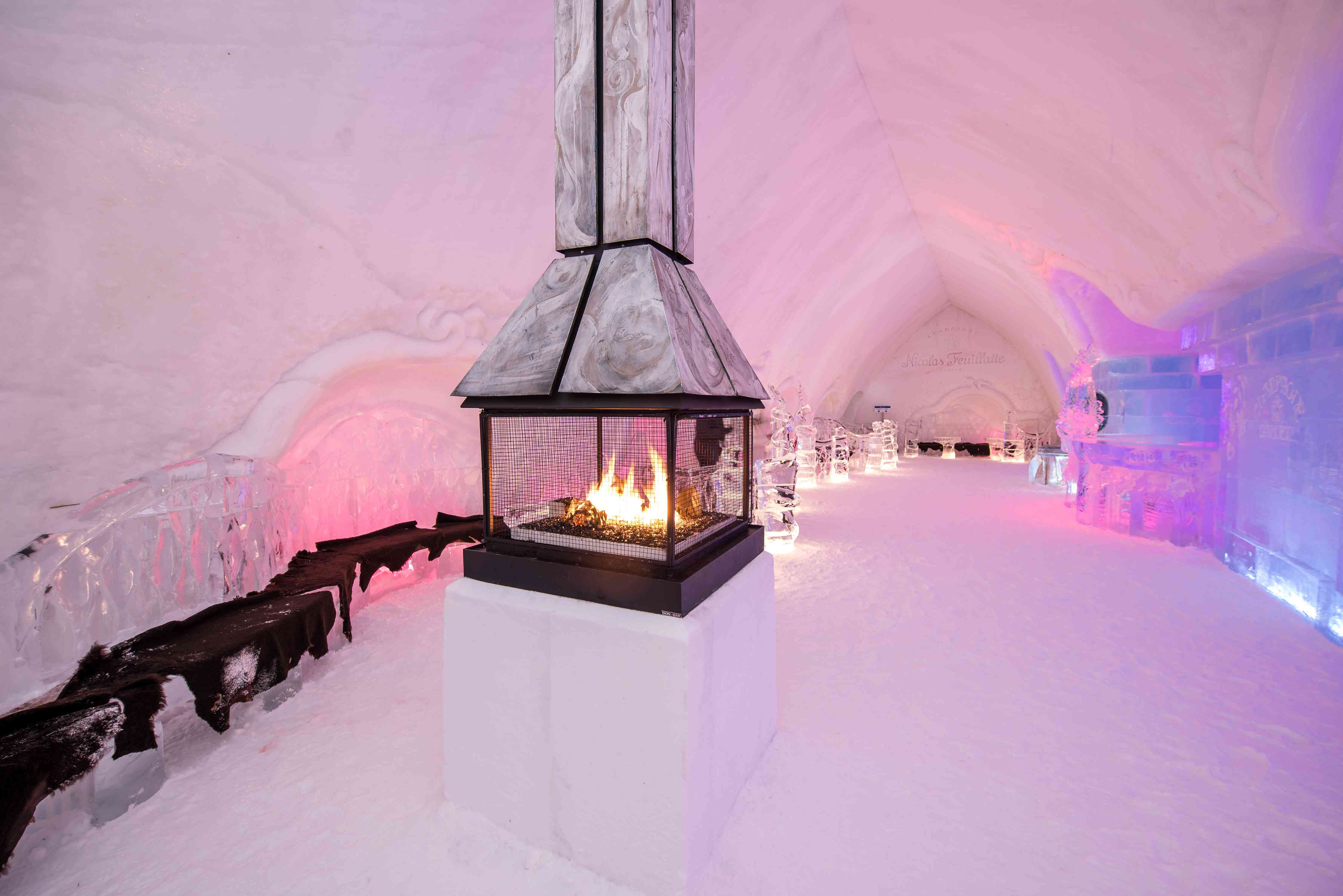 interior of the famous Hôtel de Glace with a fire place and snow walls