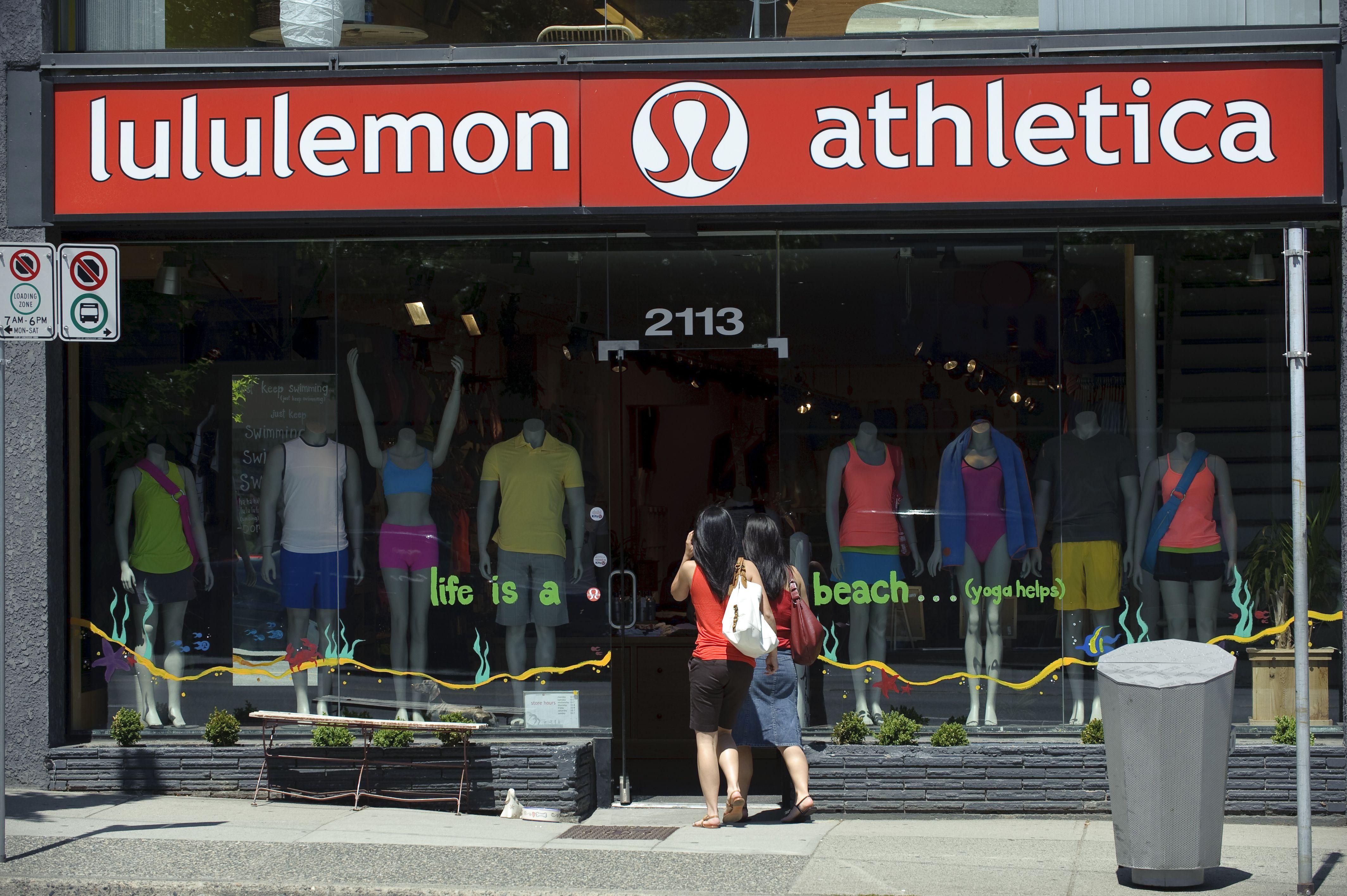 Two women entering a Lululemon store