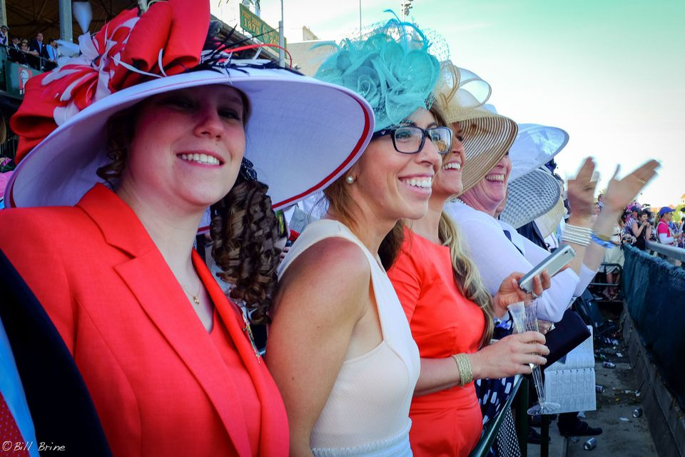 Kentucky derby hats worn by many women