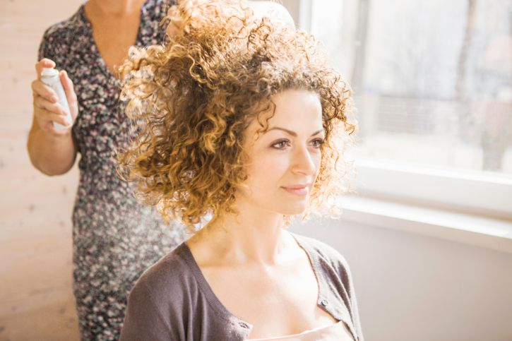 Woman With Curly Hair At Salon