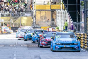 Eight F3 race cars driving in the Macao grand prix