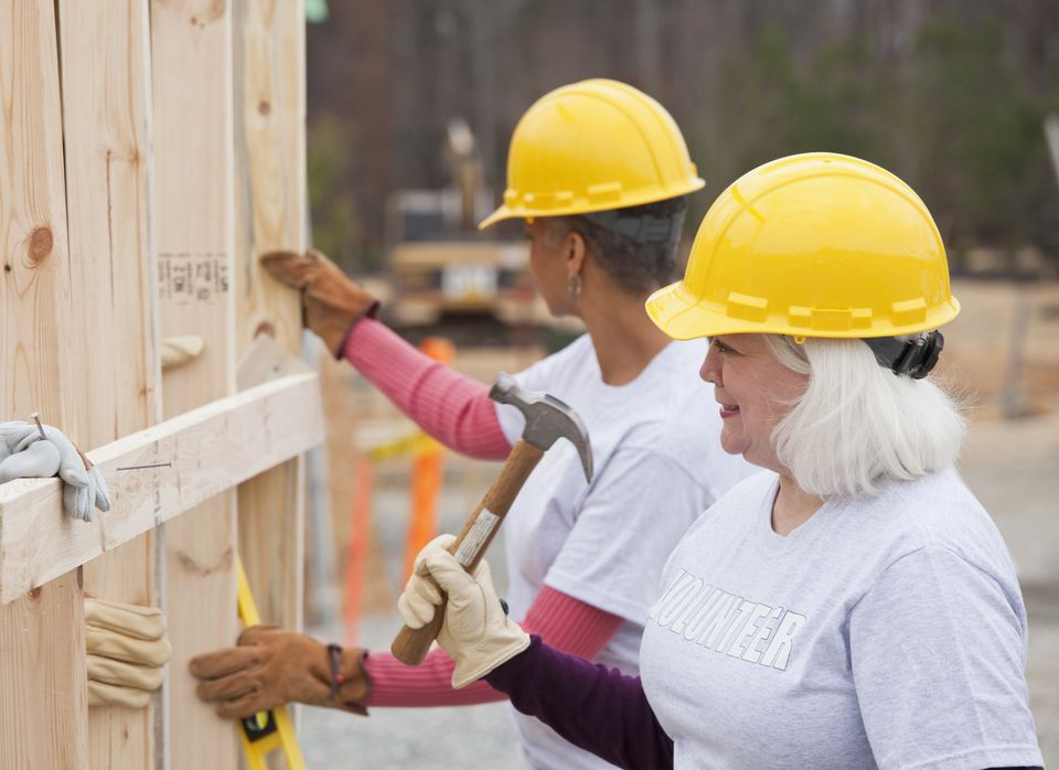 Volunteers working on Habitat for Humanity construction site
