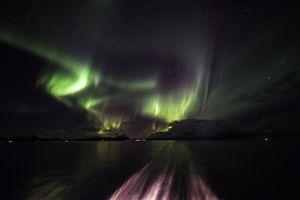 Aurora display in the wake of the Hurtigruten cruise ship, Norway.