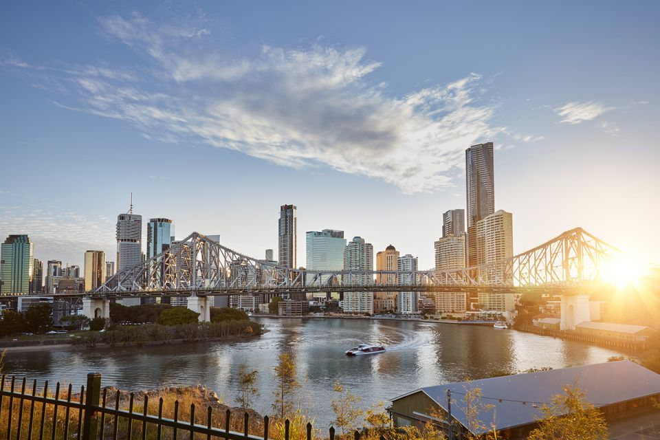Sunrise behind Story Bridge and Brisbane city skyline