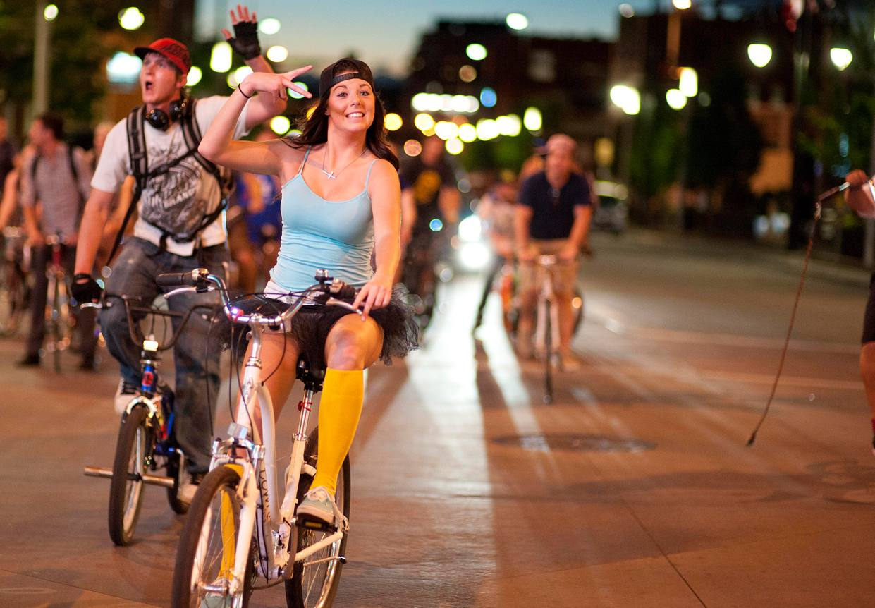 Bikers riding in Denver at night