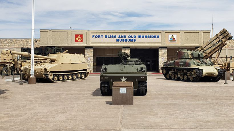 the types of military tanks in front of a building with a sign that says