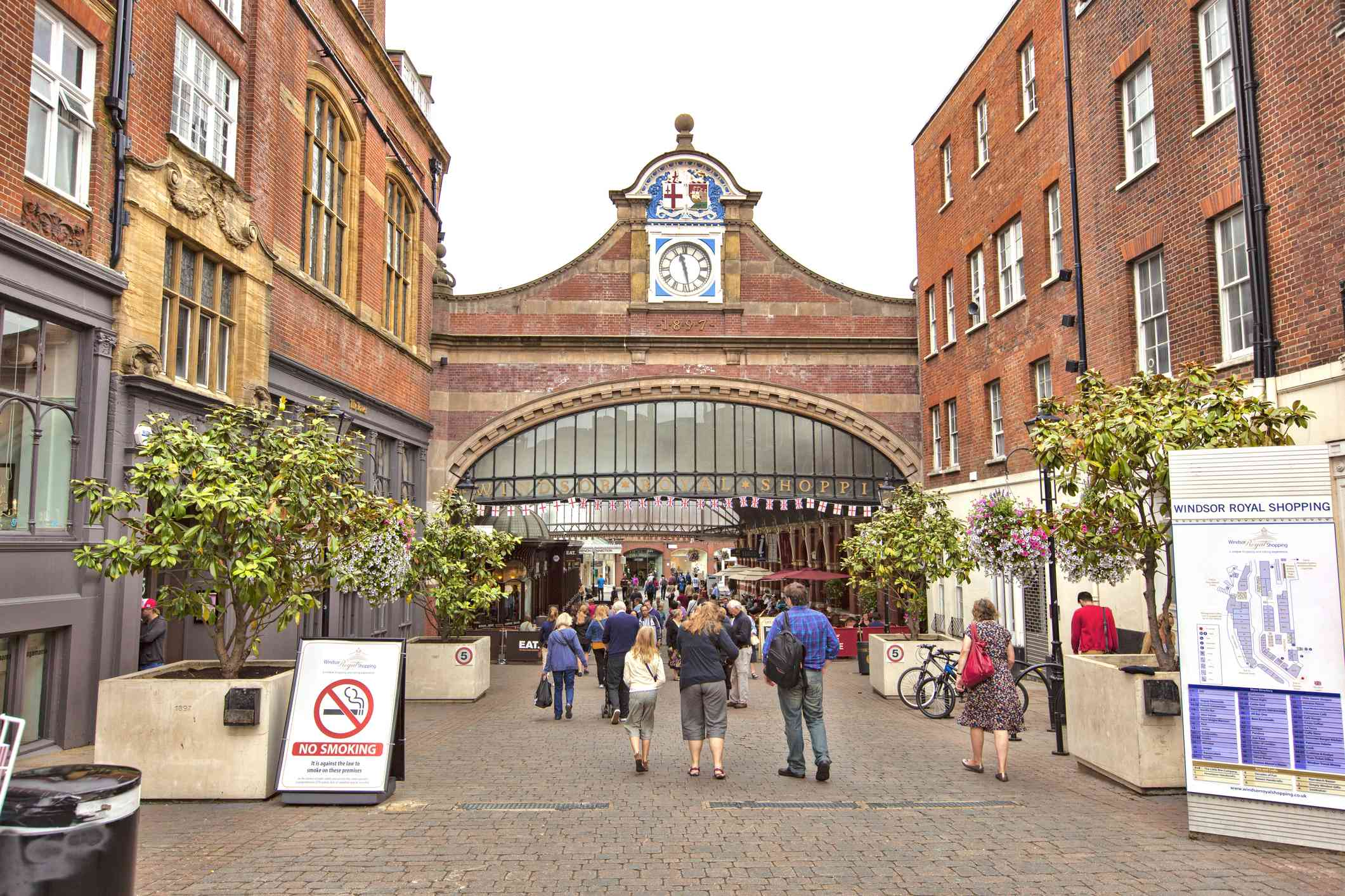 Group of people walking toward the Entrance to Windsor Royal Shopping center in Windsor, UK.