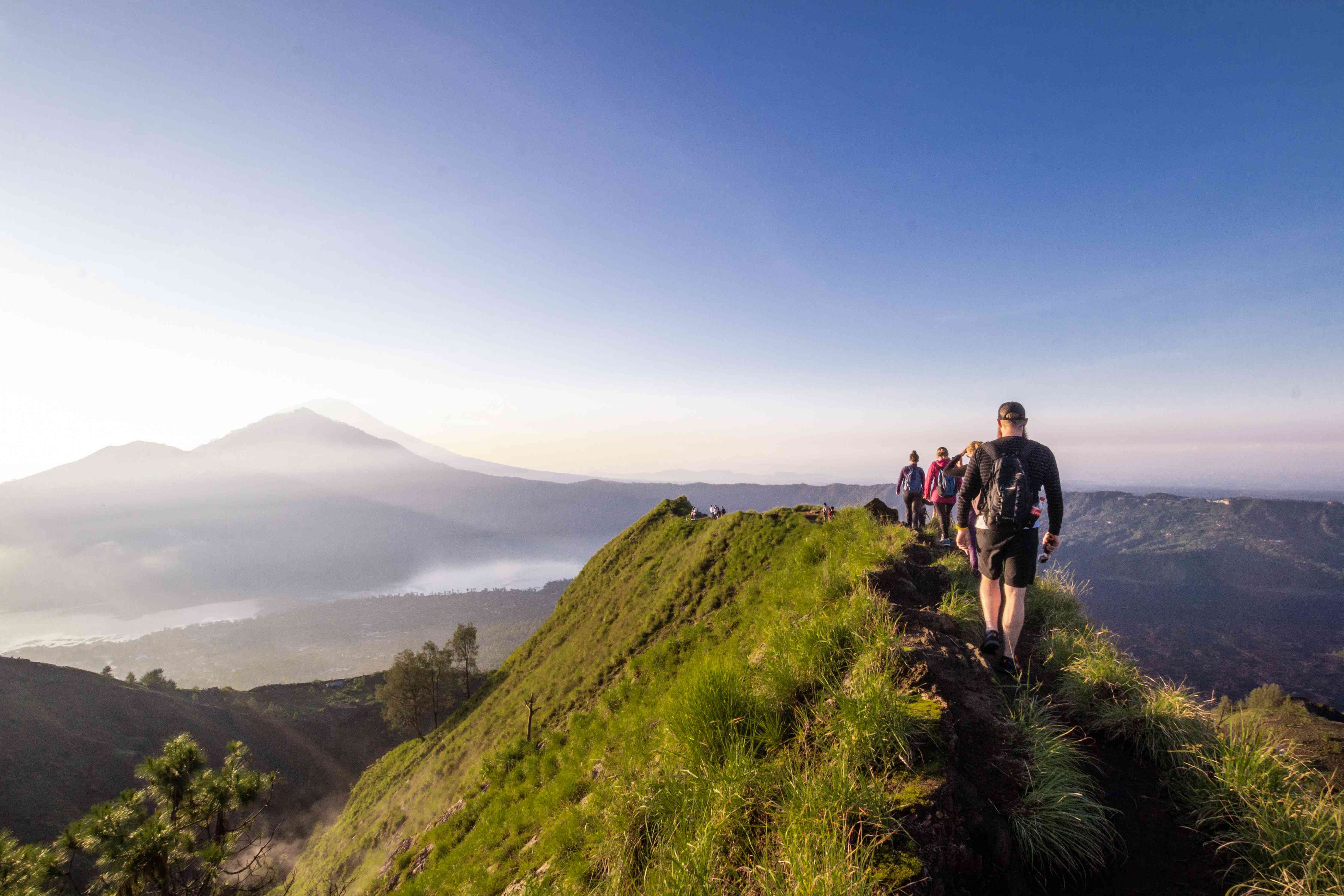 Hiking around the crater of Mount Batur with Mount Agung in the background