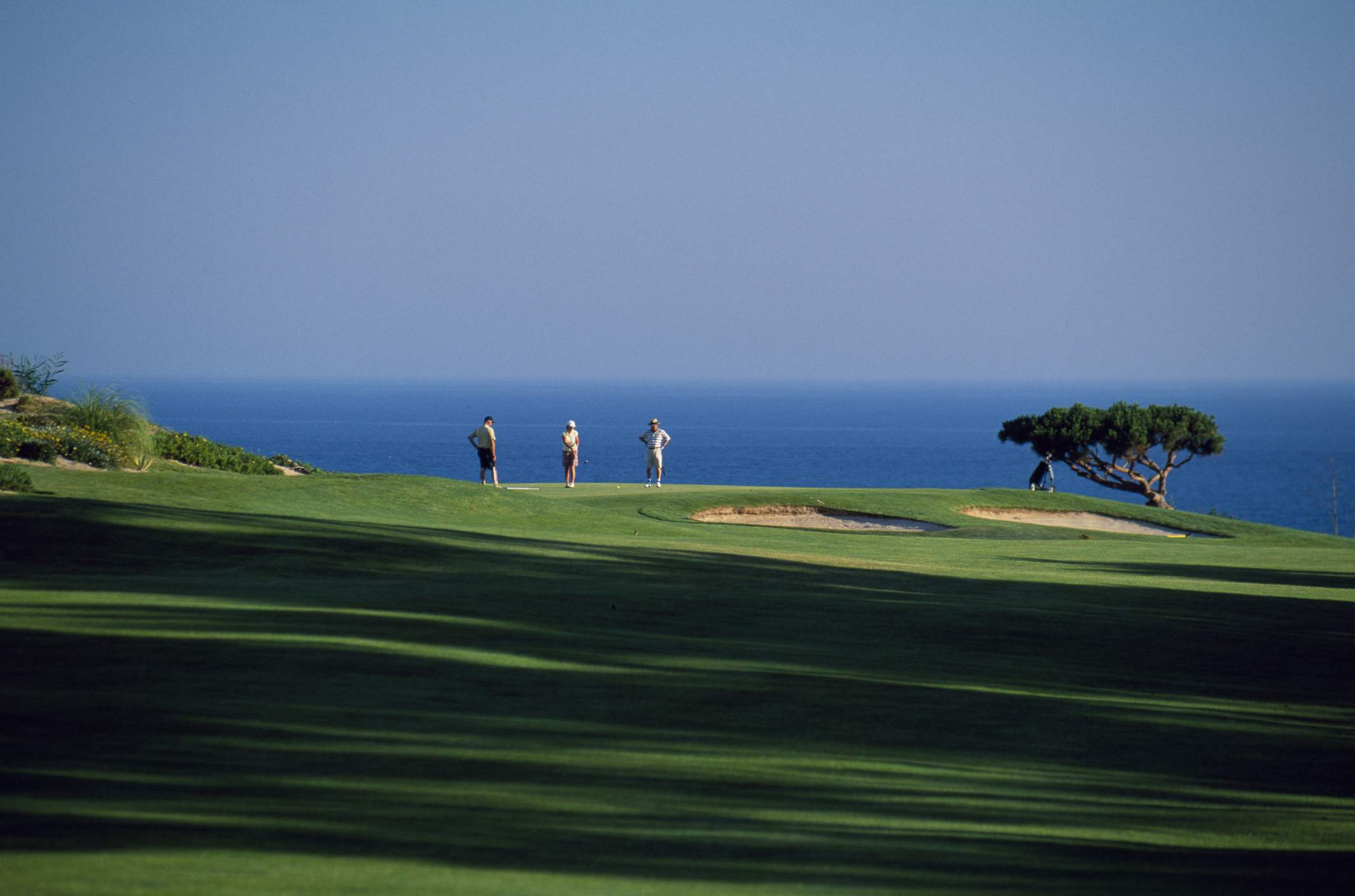 Portugal, Algarve, Val do Lobo. Golfers play on the championship course