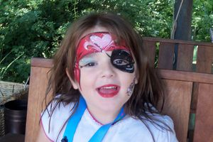 Child with pirate face painting