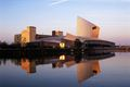 England, Manchester, Salford Quays, buildings reflected in water, dawn