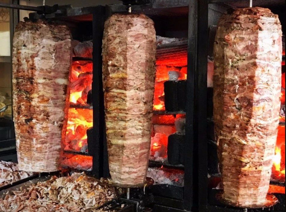 Meat cooked on a spit for Tacos Arabes