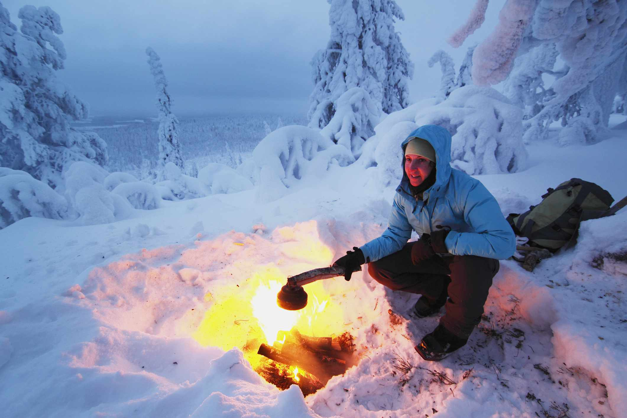 Woman camping with fire
