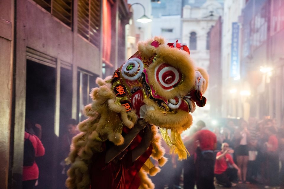 Traditional Chinese Lion Dancing and firecrackers during Chinese New Year celebrations