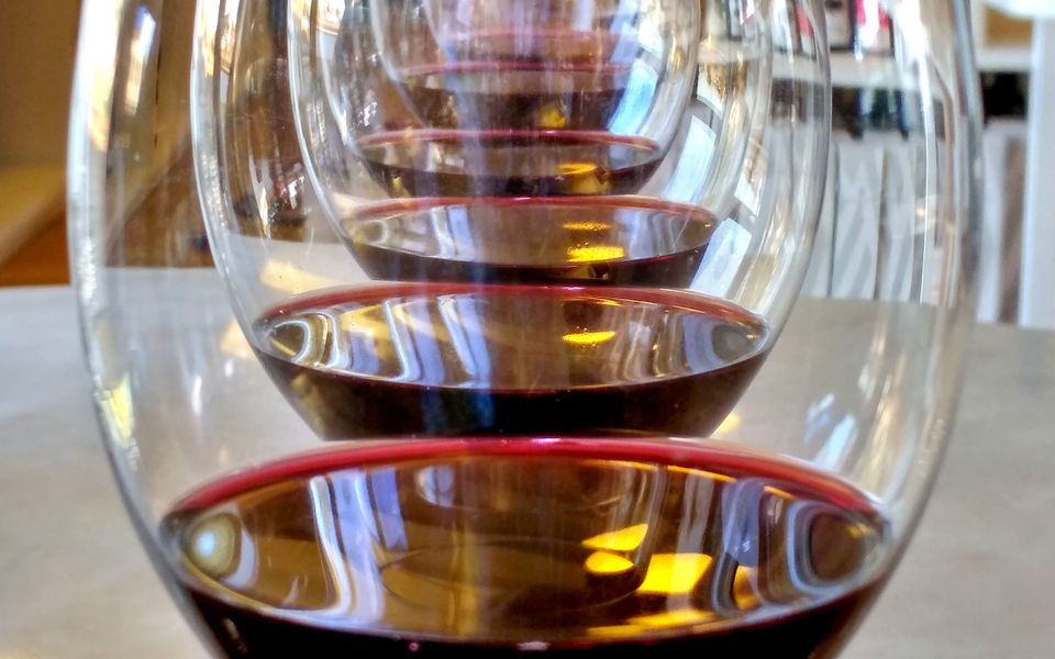 Several glasses with red wine