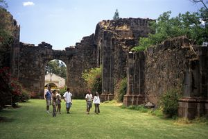 Young adult tourists admiring part of a ruined church in Mascota, Jalisco, Mexico