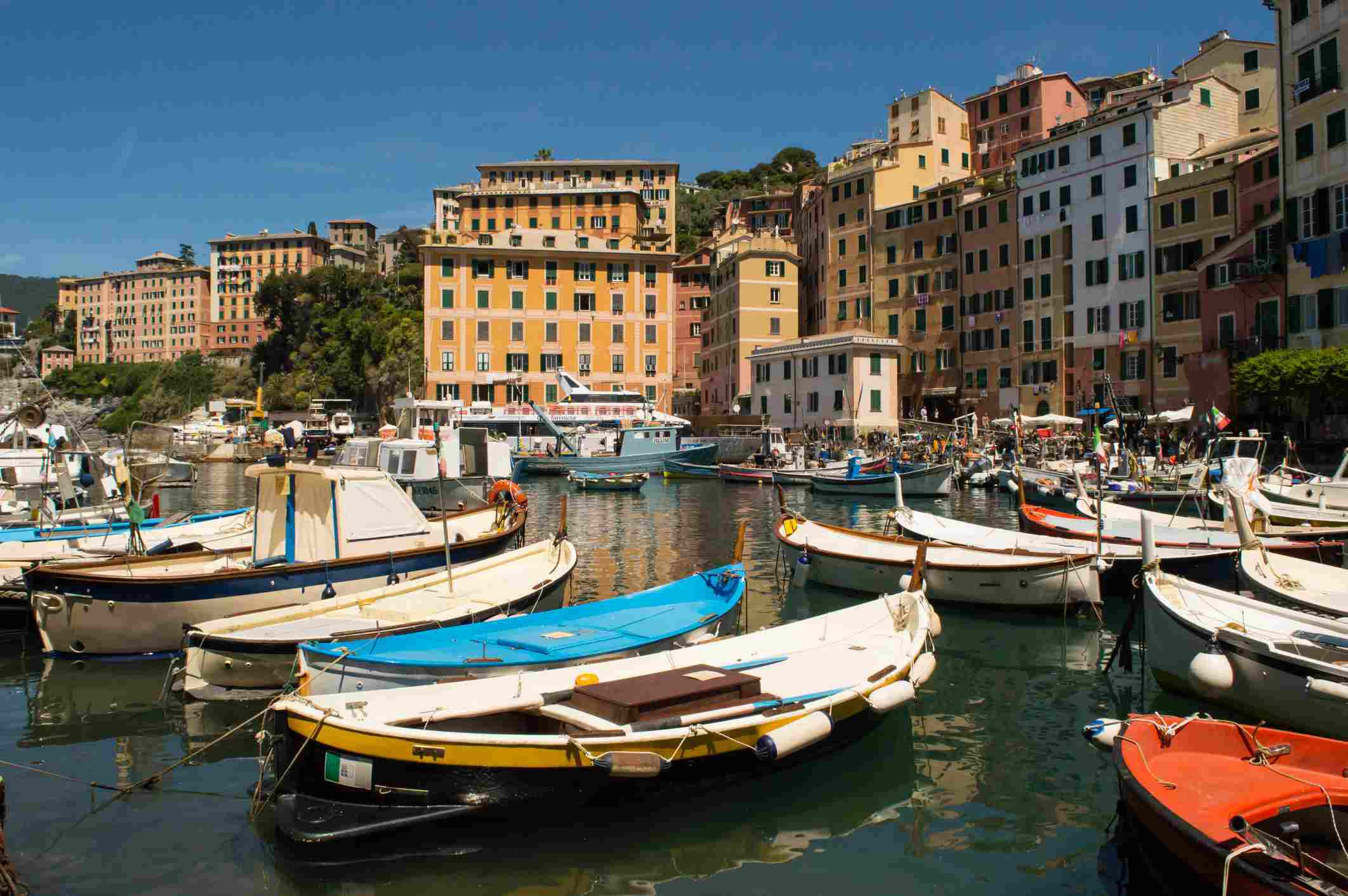 Boats moored in the harbor in Camogli, Italy