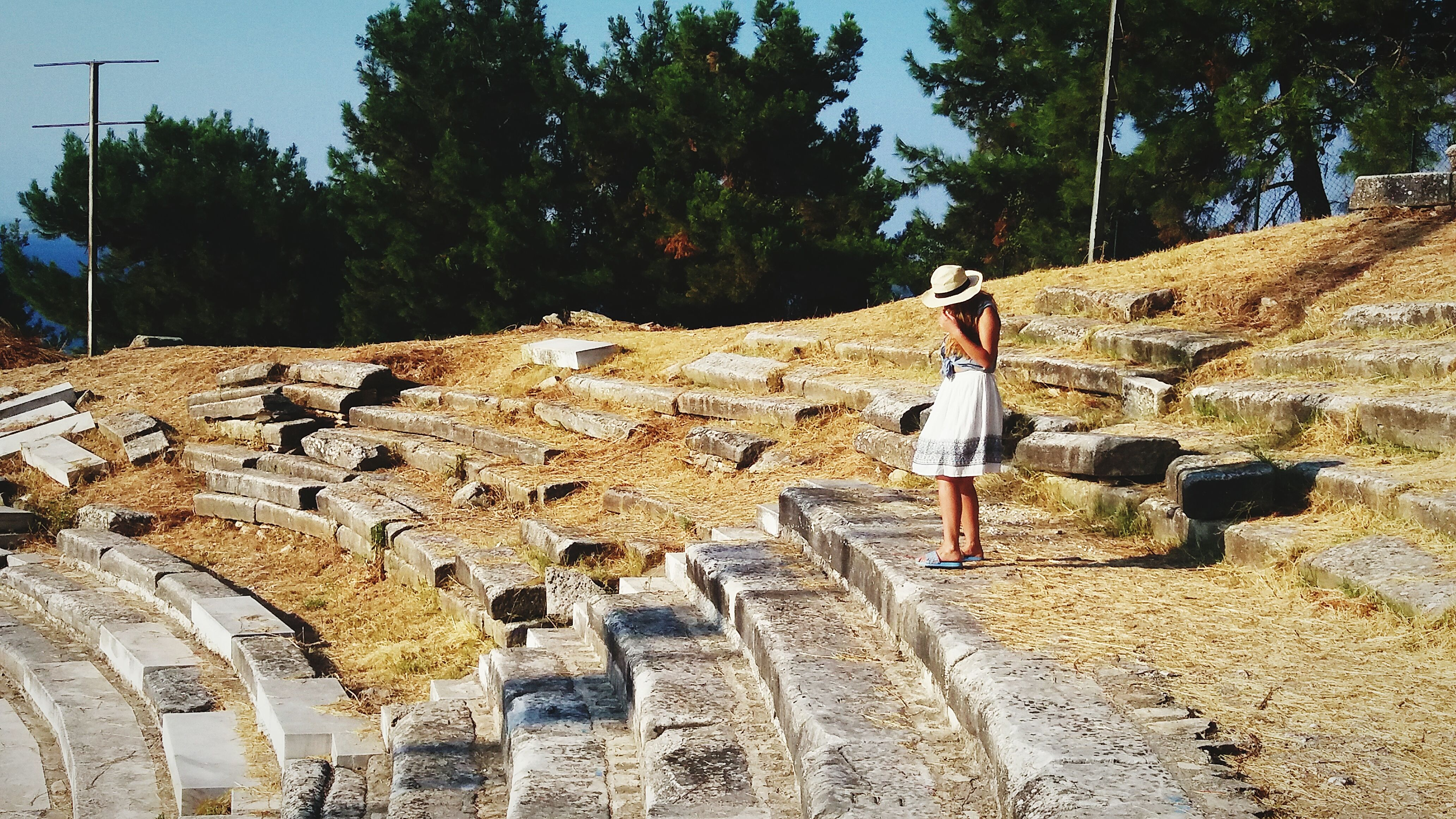 Side View Of Woman Standing On Broken Steps At Thasos Island