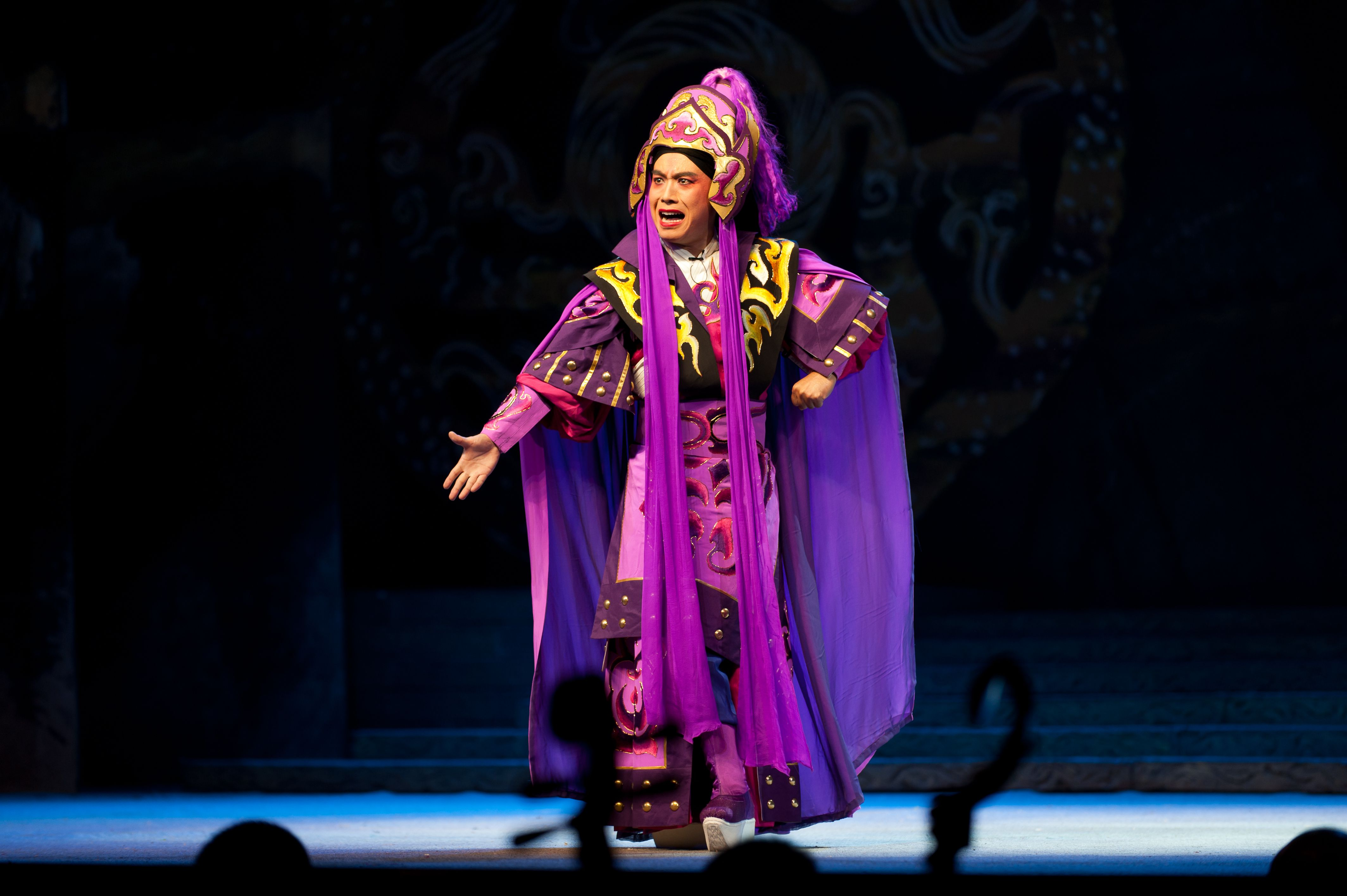 Performer in purple traditional attire at Beijing Opera
