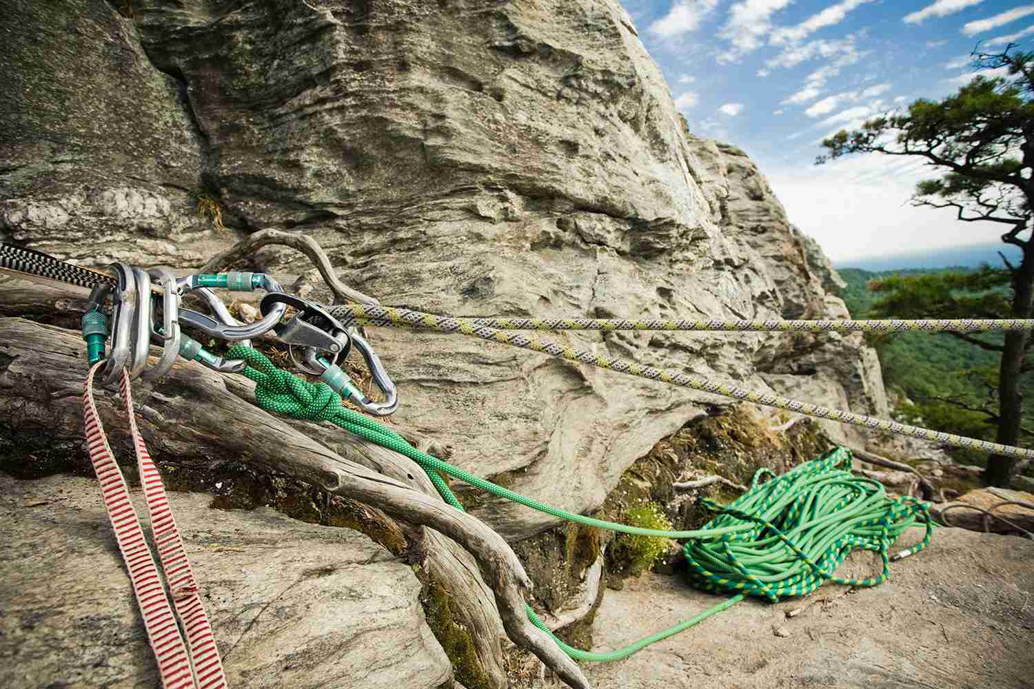 Carabiners on an anchor attached to cliff.