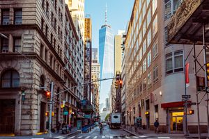 Street in Downtown Manhattan with One World Trade Center in the center, New York, USA
