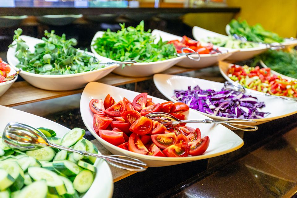 Salad bar with fresh vegetables in hotel buffet