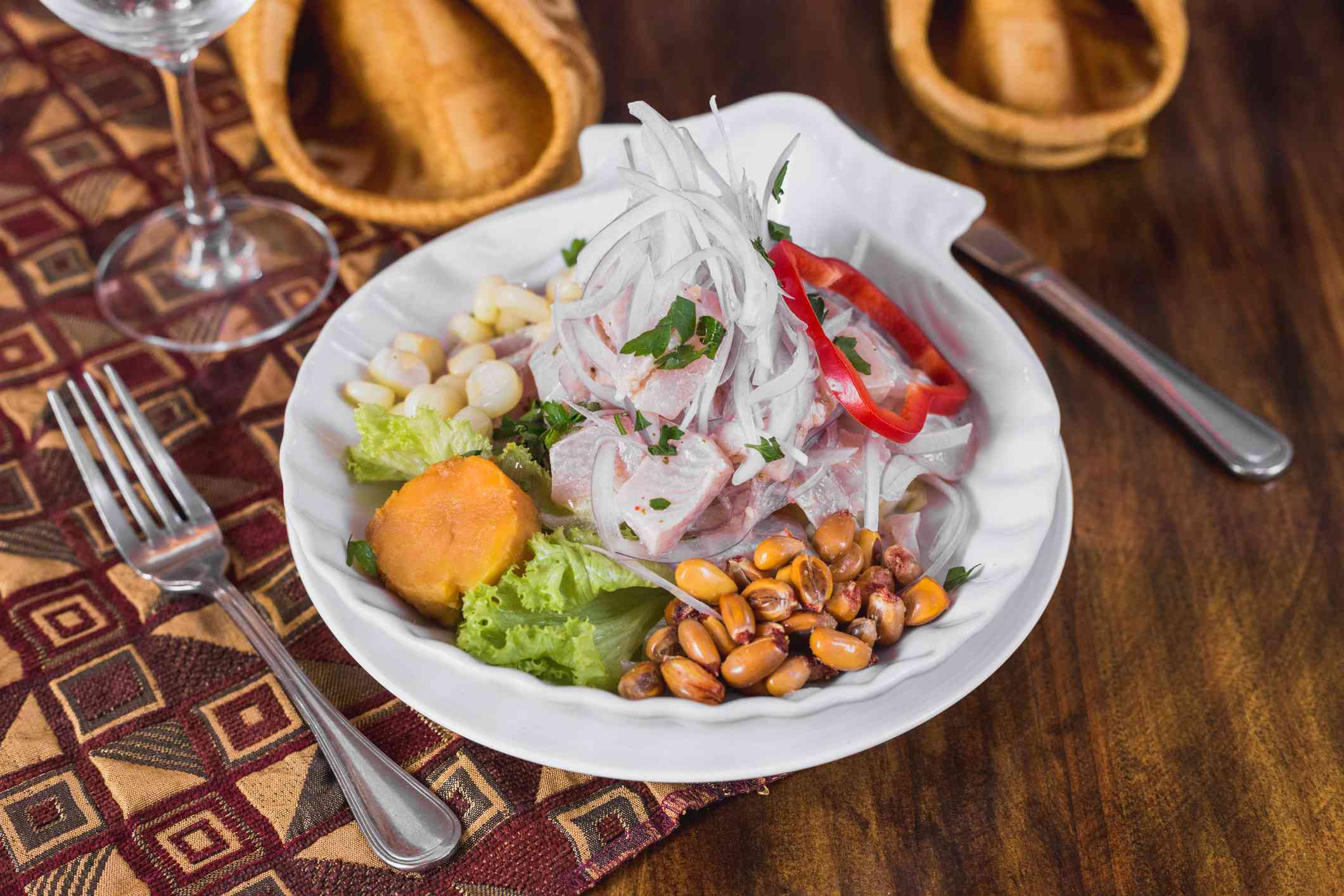 large plate of Ceviche on a wooden table