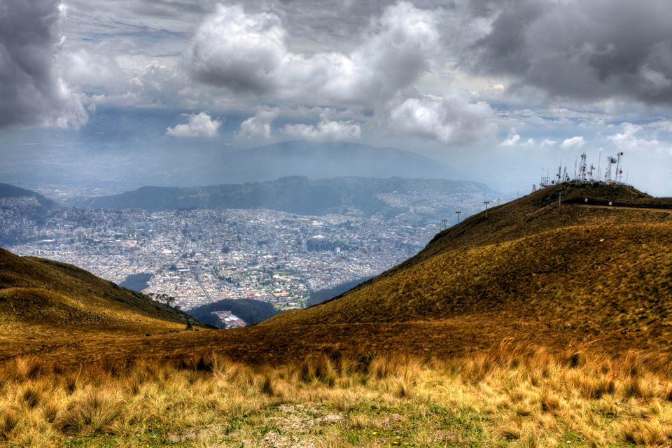 A dramatic view of the Spanish language city of Quito, and the Ecuadorian countryside surrounding it