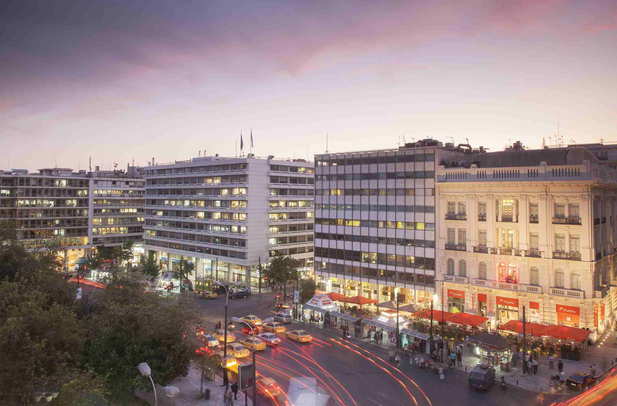 Taxis in Syntagma Square at dusk, Athens, Greece