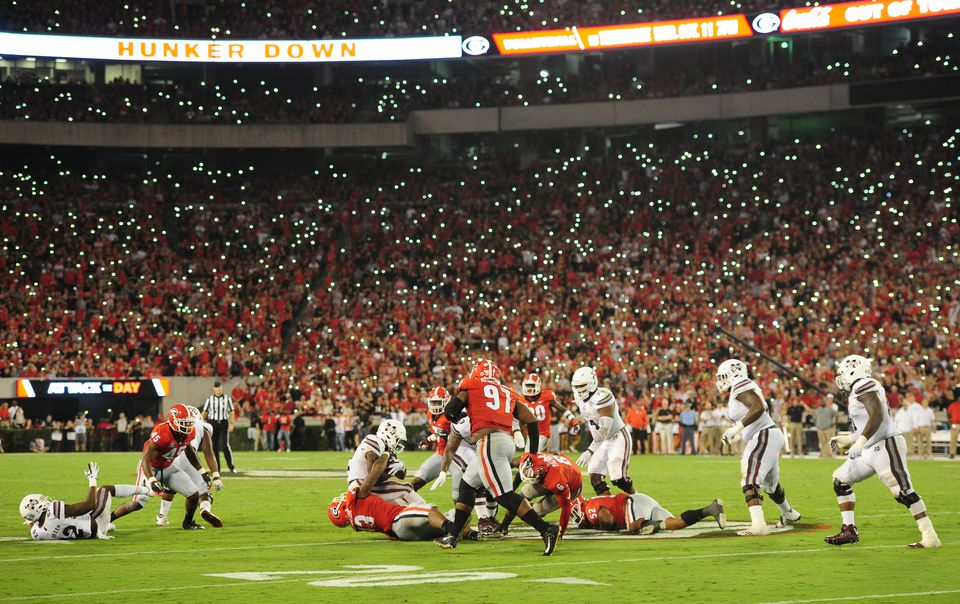 fans light up Sanford Stadium