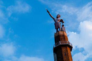 Statue of man holding a spear at Vulcan Sculpture Garden