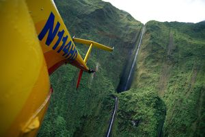 Hawaii view from helicopter tall thin waterfall along West Maui mountains