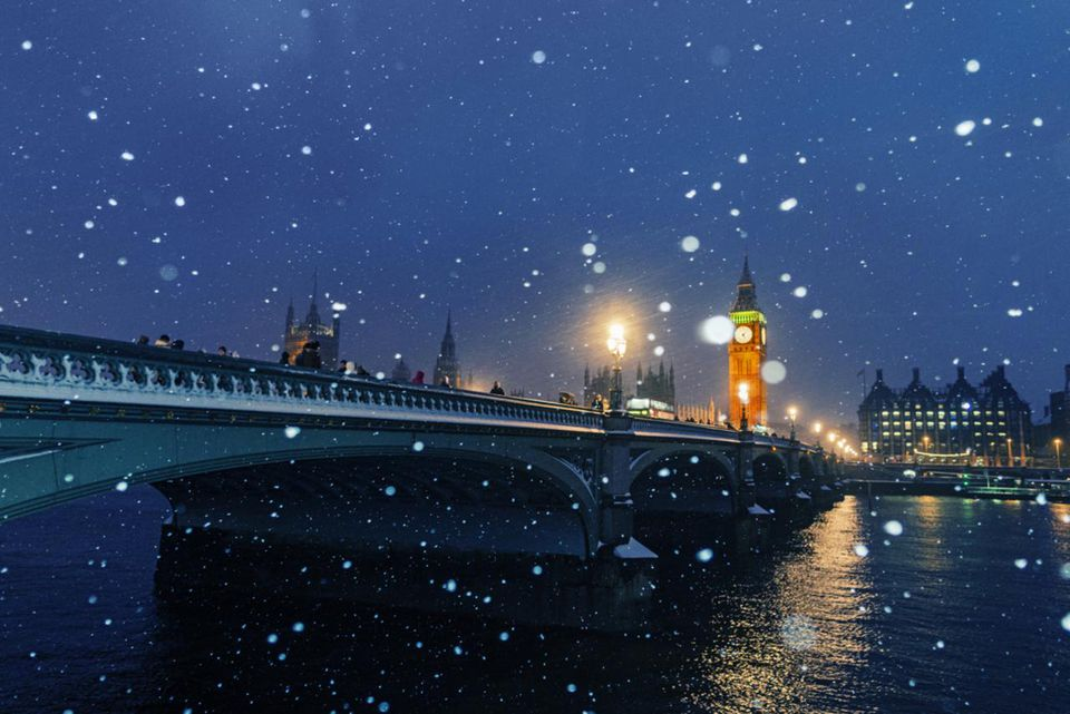 Westminster Bridge and Big Ben in snow, London,UK