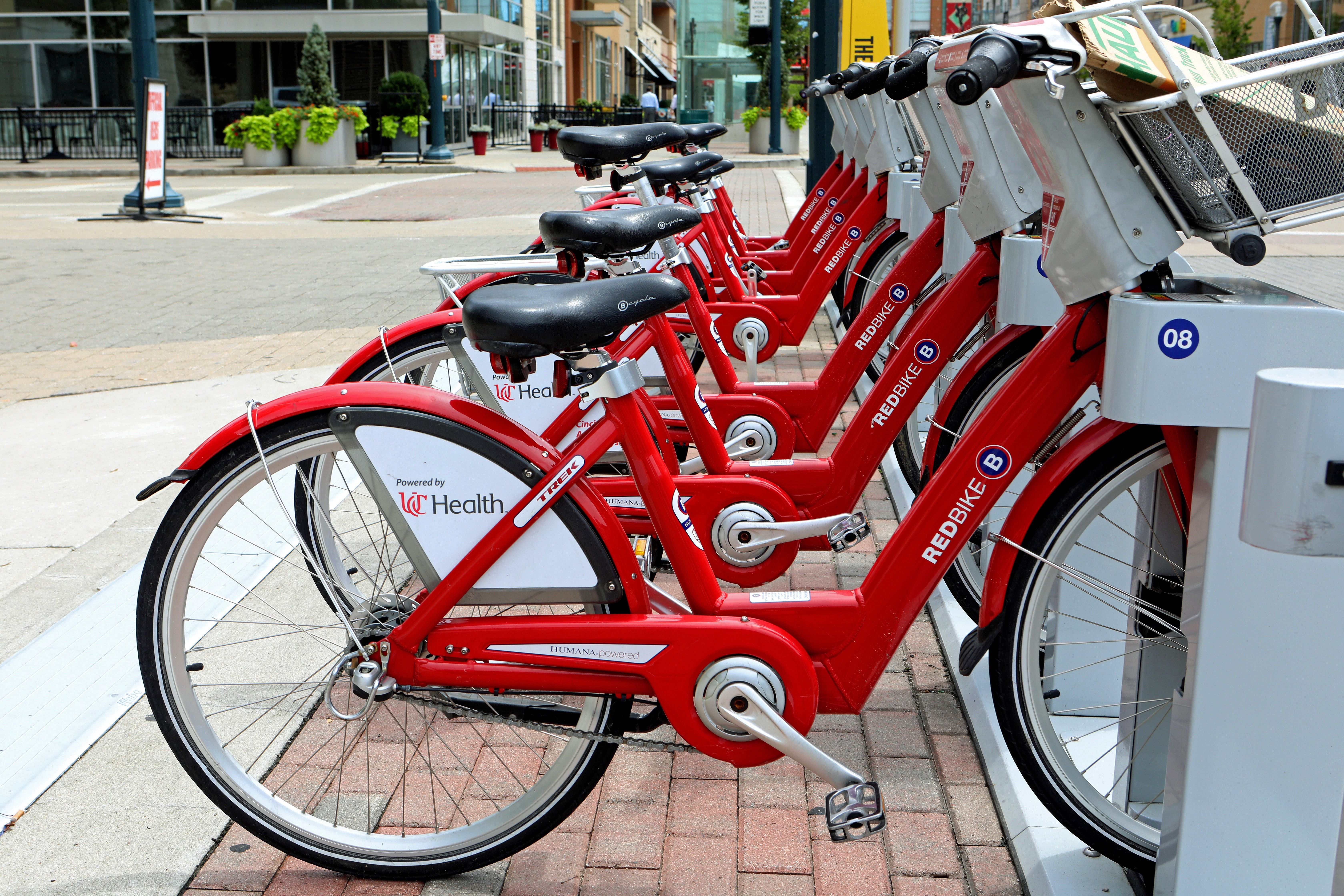 The Cincinnati Red Bikes service offers an economical way to see the city.