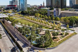 Aerial view of klyde warren park with dallas skyscrapers in the background