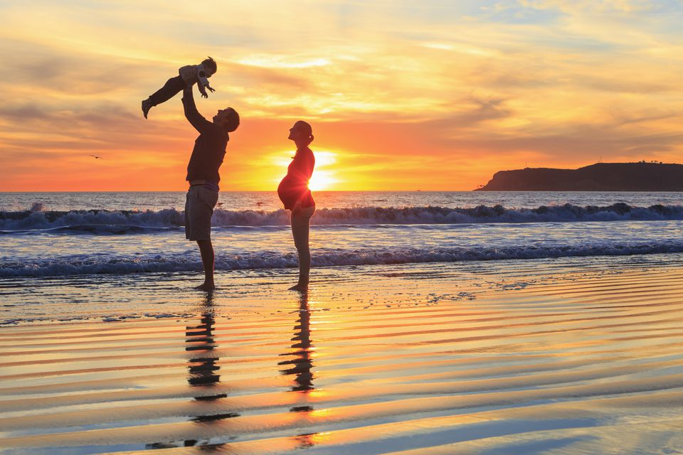 Family with toddler son playing on beach, San Diego, California, USA