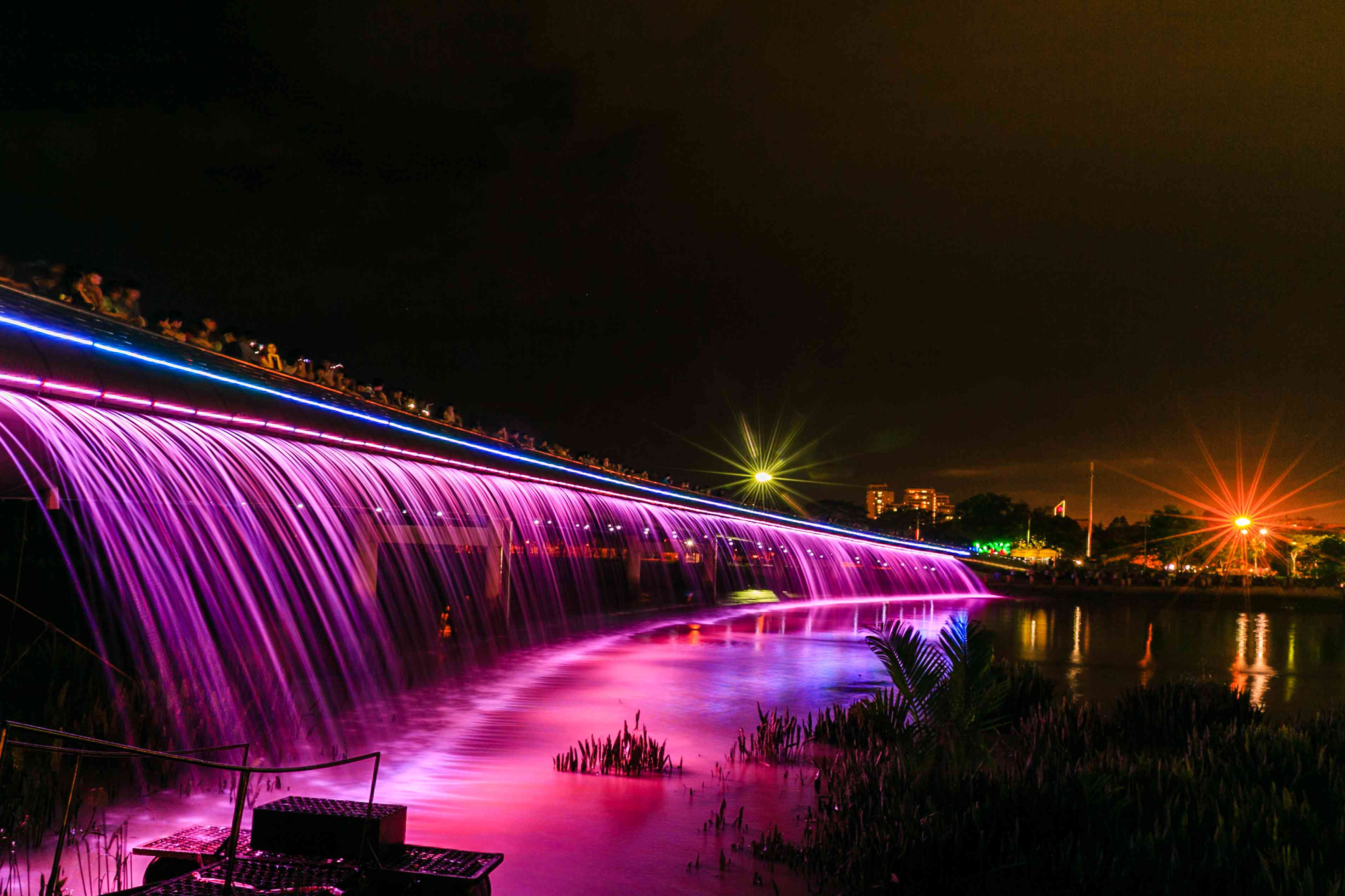Starlight Bridge illuminated outside Crescent Mall in Ho Chi Minh City