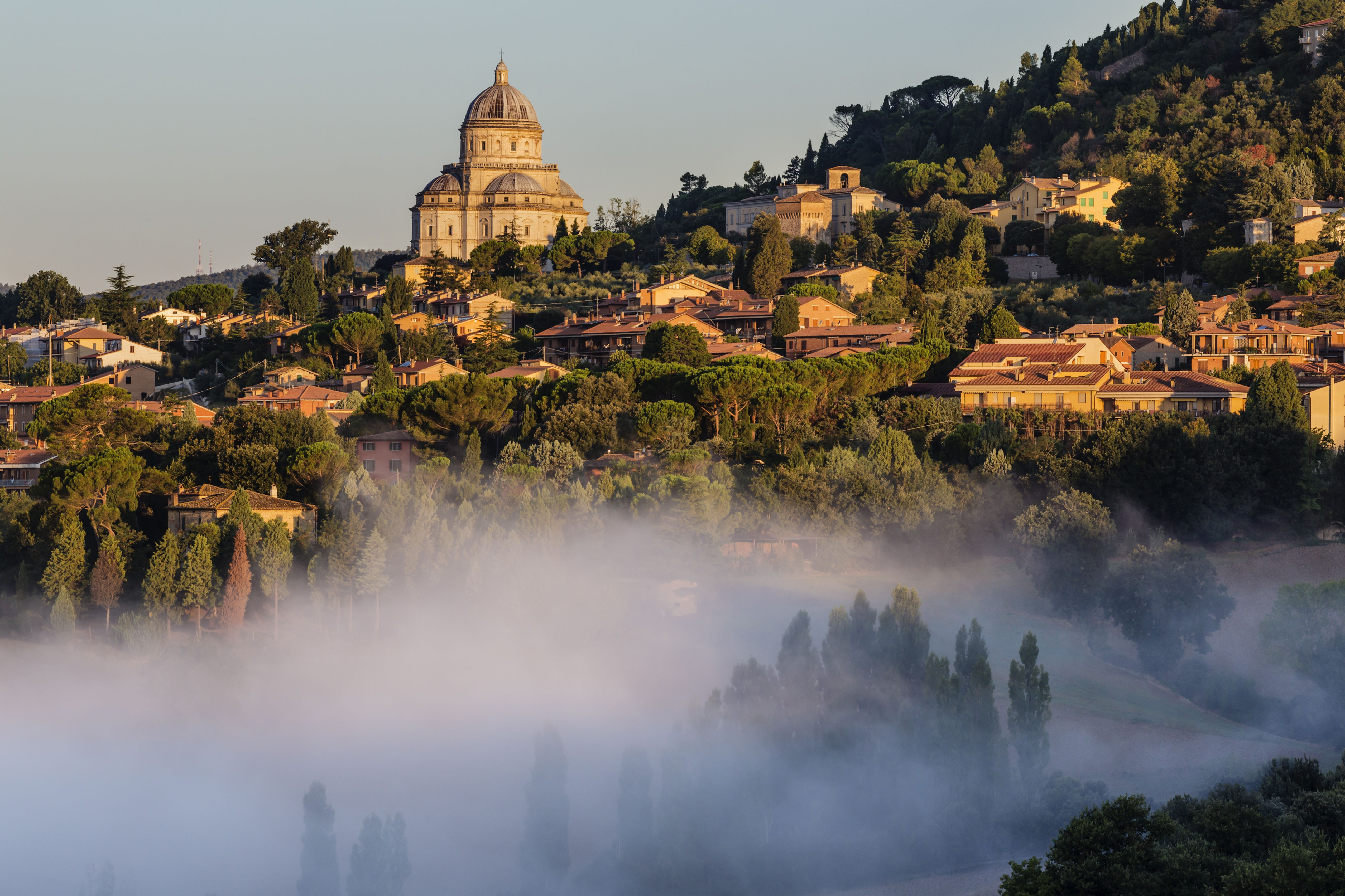 Morning fog and hill town, Todi, Umbria, Italy