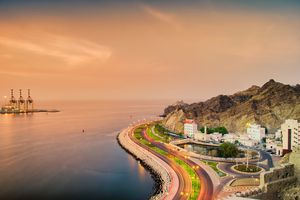 Panoramic View of a cruving seaside road in Muscat, Oman at sunset